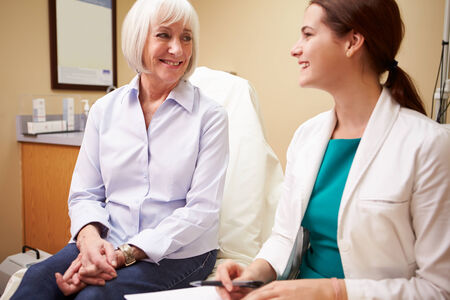 Doctor In Consultation With Senior Female Patient Stock Photo