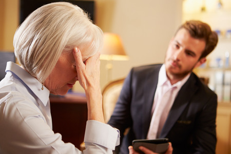 counsellor: Woman Talking To Male Counsellor Using Digital Tablet