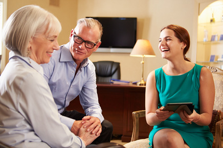 financial advice: Older Couple Talking To Financial Advisor In Office