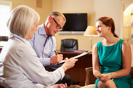 Older Couple Talking To Financial Advisor In Office photo