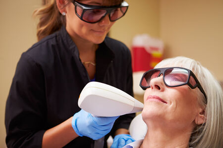 Woman Having Laser Treatment At Beauty Clinic photo