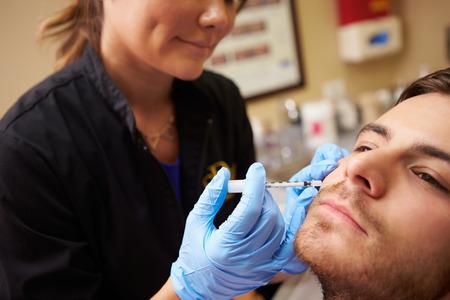 botox: Man Having Botox Treatment At Beauty Clinic