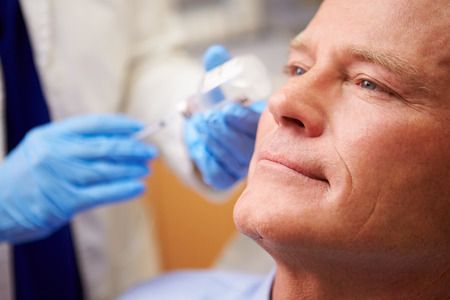 Man Having Botox Treatment At Beauty Clinic