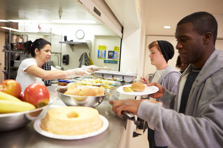 Kitchen Serving Food In Homeless Shelter photo