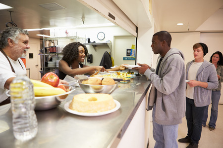 Kitchen Serving Food In Homeless Shelter