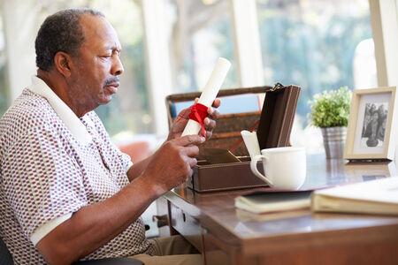 storing: Senior Man Putting Will Into Box