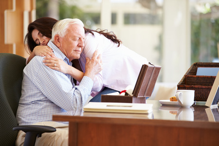 comforted: Senior Father Being Comforted By Adult Daughter