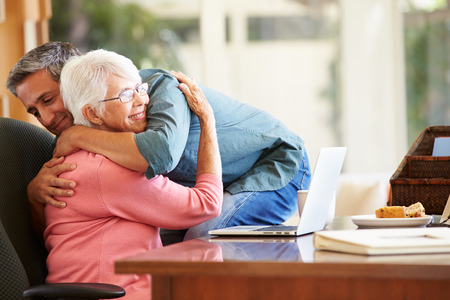 comforted: Senior Mother Being Comforted By Adult Son