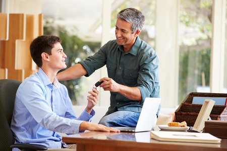 Father Giving Teenage Son Car Keys Stock Photo