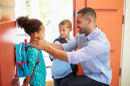 parenthood: Father Saying Goodbye To Children As They Leave For School Stock Photo
