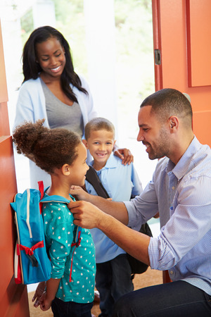 backpack: Father Saying Goodbye To Children As They Leave For School Stock Photo