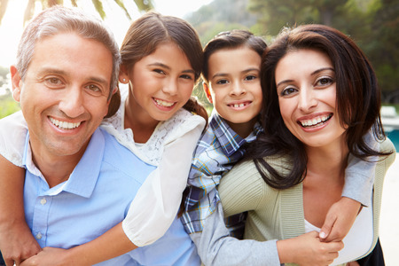 Portrait Of Hispanic Family In Countryside photo