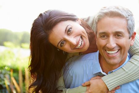 hispanic couple: Portrait Of Loving Hispanic Couple In Countryside