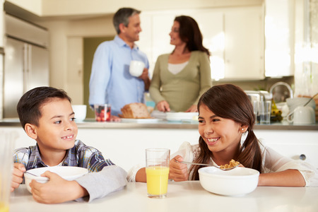Hispanic Family Eating Breakfast At Home Together photo