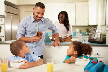 Family Eating Breakfast At Home Together photo
