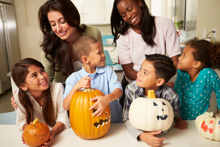 Mothers And Children Making Halloween Lanterns photo
