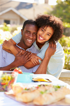Romantic Couple Enjoying Outdoor Meal In Garden photo