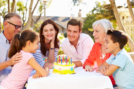 three year old: Multi-Generation Family Celebrating Birthday In Garden Stock Photo