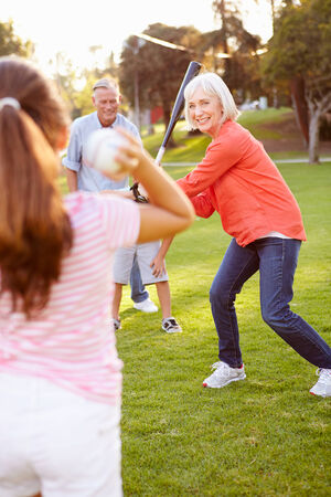 grandkid: Grandparents Playing Baseball With Grandchildren In Park Stock Photo
