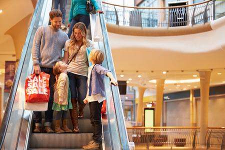 Family On Escalator In Shopping Mall Together Archivio Fotografico