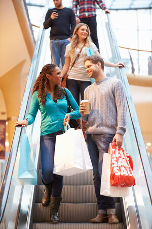 Couple On Escalator In Shopping Mall Together photo