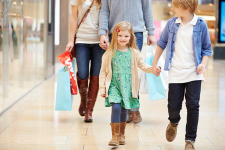shopping centre: Children On Trip To Shopping Mall With Parents