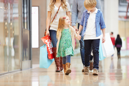Children On Trip To Shopping Mall With Parents
