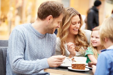Family Enjoying Snack In Cafe Together Stockfoto