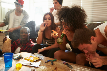 bong: Gang Of Young People Taking Drugs Stock Photo