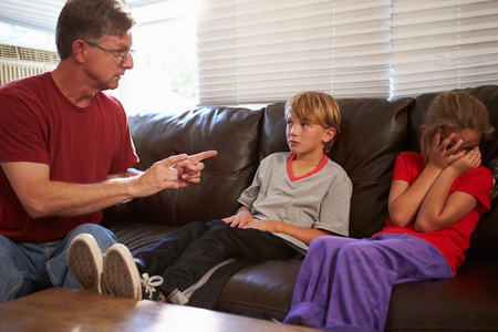 physically: Father Being Physically Abusive Towards Children At Home Stock Photo
