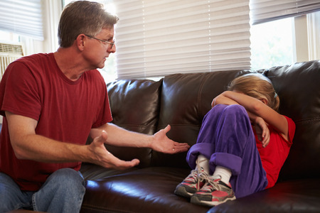Father Telling Off Daughter At Home photo