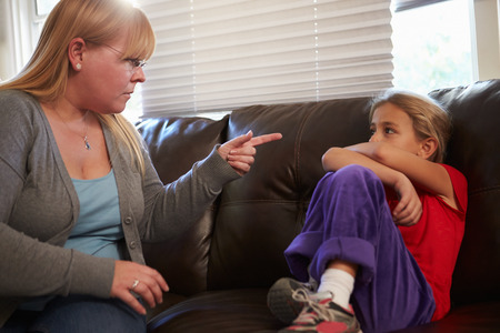 Mother Telling Off Daughter At Home photo