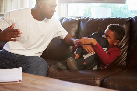 Father Being Physically Abusive Towards Son At Home photo