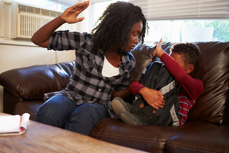 Mother Being Physically Abusive Towards Son At Home photo
