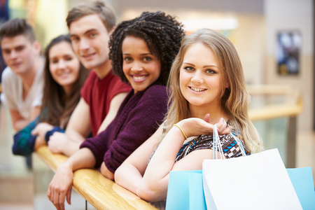 Group Of Young Friends Shopping In Mall Together photo