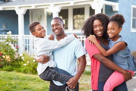 Portrait Of Family Outside Suburban Home photo