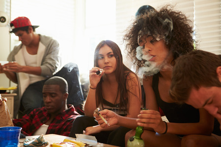 smoking: Gang Of Young People Taking Drugs Stock Photo