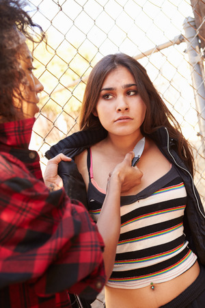 threatened: Girl Being Threatened With Knife By Female Gang Member Stock Photo