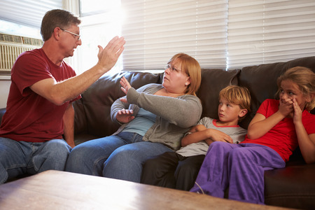 Physically Abusive Father With Family On Sofa photo