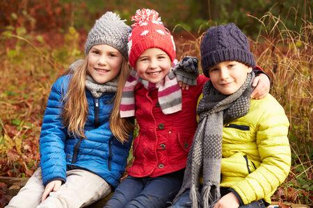 Three Children On Walk Through Winter Woodland Reklamní fotografie