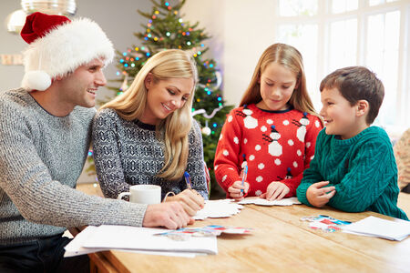 Family Writing Christmas Cards Together photo
