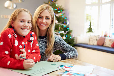 Mother And Daughter Writing Letter To Santa Together photo