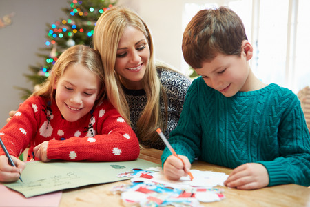 Mother And Children Writing Letter To Santa Together photo