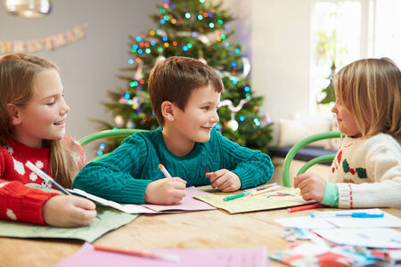 Three Children Writing Letters To Santa Together photo