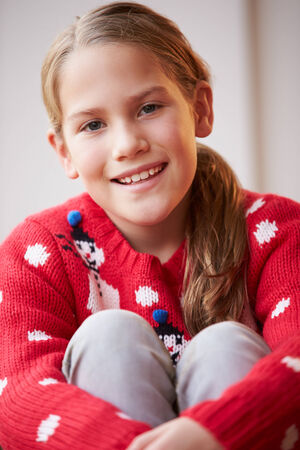 8 years: Portrait Of Girl Wearing Christmas Jumper