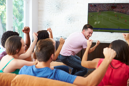 match: Group Of Friends Watching Soccer Celebrating Goal