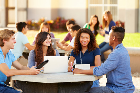 happy old people: High School Students Hanging Out On Campus Stock Photo