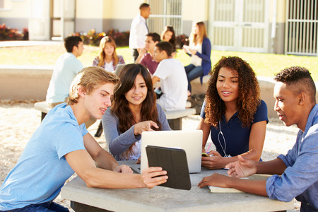 High School Students Hanging Out On Campus Stock Photo