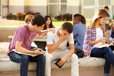 teen girls: Male High School Student Comforting Unhappy Friend Stock Photo