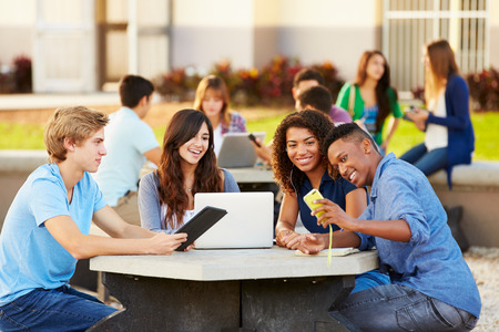 working out: High School Students Hanging Out On Campus Stock Photo